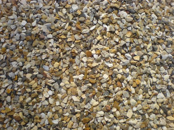 Resin Bonded Aggregate And Bitumen And Chipping Surface