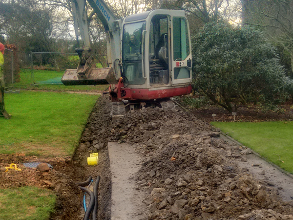 Excavating a trench for power cables